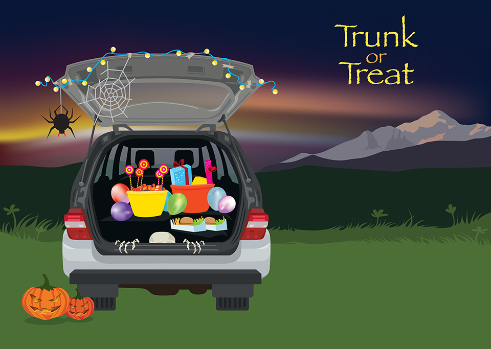 An SUV with its hatch open reveals Halloween goodies inside.