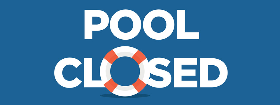 A sign reads 'Pool Closed' with a life preserver acting as the 'O' in CLOSED.