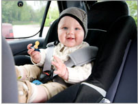 Photo of a happy baby in a car seat.
