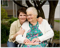 Photo of an elderly woman with her caregiver.
